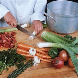 Chef preparing leek