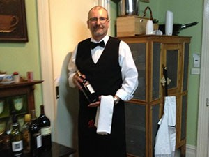 Martin serving wine at Mananga house Berry